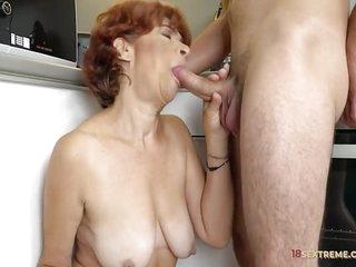 Redhead Granny Riding a Hard Wang
