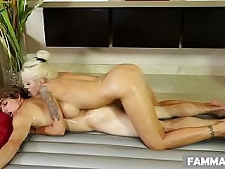 Busty stepmom Nina Elle massaging her son
