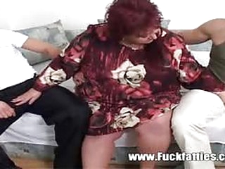 Fat mature slut escorting and fucking two very horny boys cumming all over her face