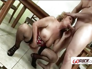 Delicious pussy of an old mature lady is filled with long boner of a younger guy with long dick